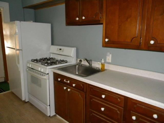 Kitchen featured at 407 W 9th St, Sterling, IL 61081