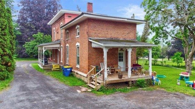 Porch yard featured at 11917 W Main St, Wolcott, NY 14590