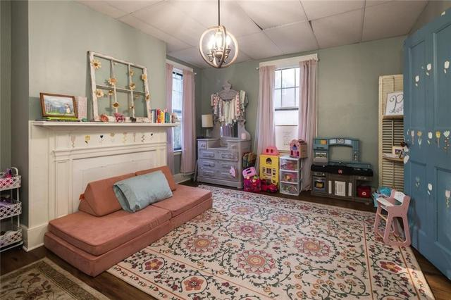 Living room featured at 31 High St, Lyons, NY 14489