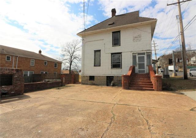 Porch yard featured at 222 N 1st St, Pacific, MO 63069