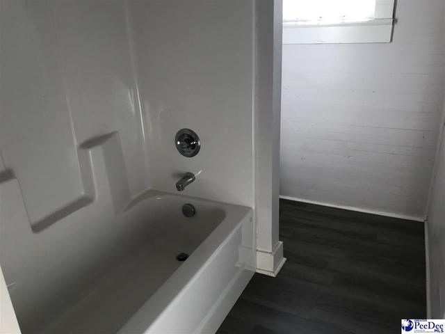 Bathroom featured at 142 Williamsburg Ave, Lake City, SC 29560