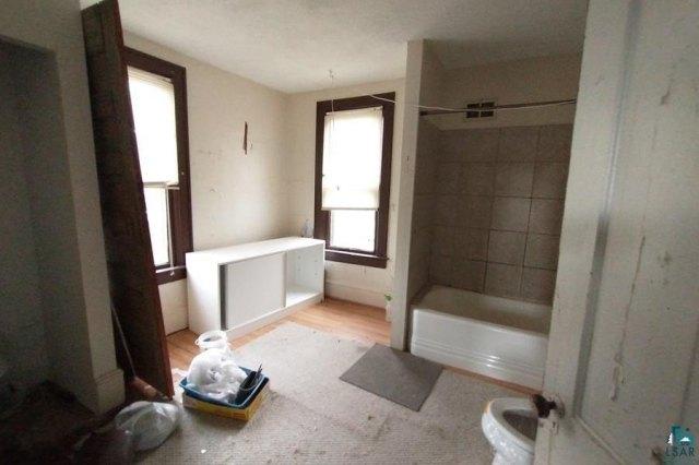 Bathroom featured at 106 S Poplar Ln, Hinckley, MN 55037