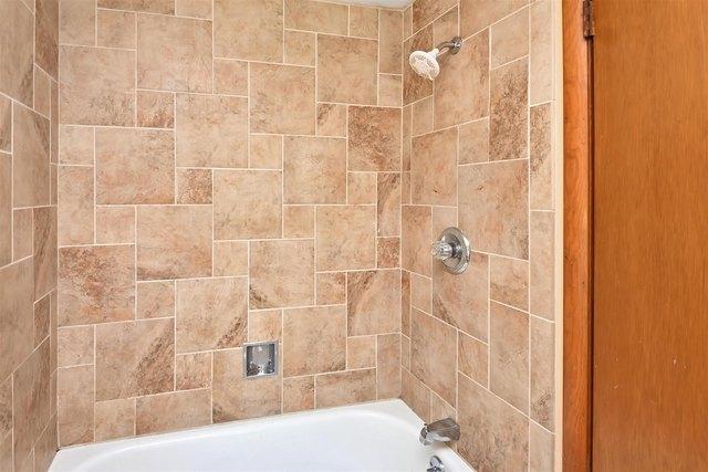 Bathroom featured at 100 Iowa Ave, Holton, KS 66436
