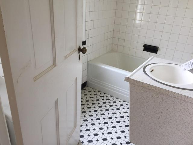 Bathroom featured at 14 S 88th St, Belleville, IL 62223