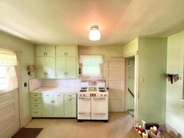 Kitchen featured at 114 N Washington Ave, Springfield, MN 56087