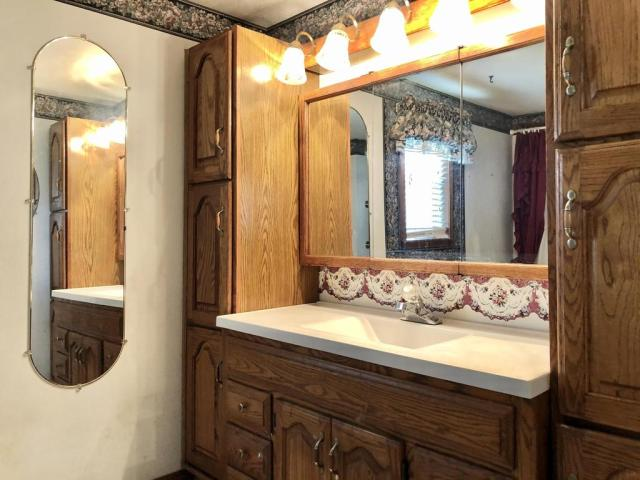Bathroom featured at 703 Commercial St, Purdy, MO 65734