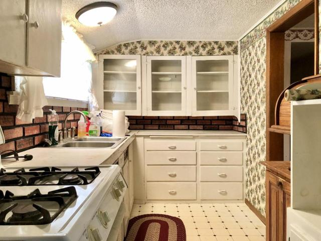 Laundry room featured at 703 Commercial St, Purdy, MO 65734