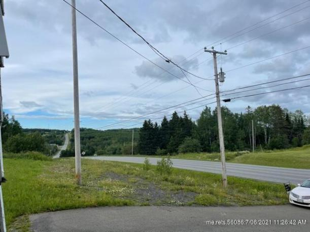 Road view featured at 1951 Aroostook Rd, Wallagrass, ME 04781