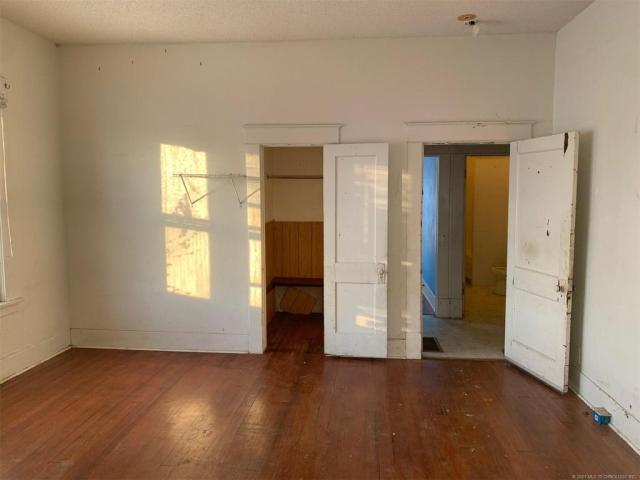 Property featured at 702 E Broadway St, Muskogee, OK 74403