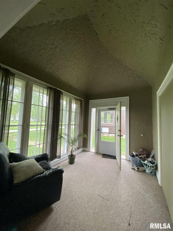 Living room featured at 132 Chandler Blvd, Macomb, IL 61455