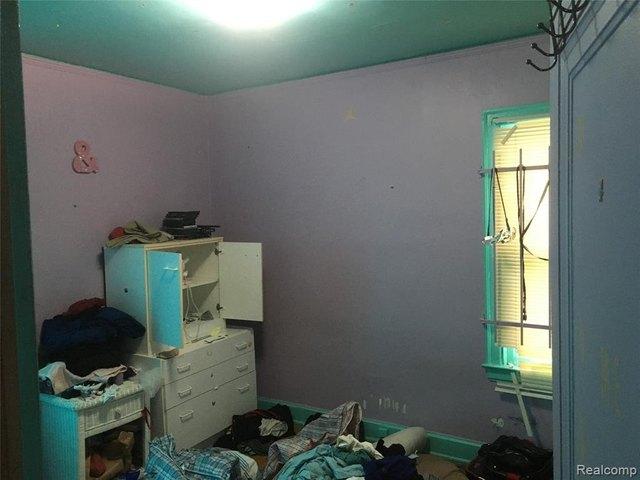 Bedroom featured at 3010 Fullerton St, Detroit, MI 48238