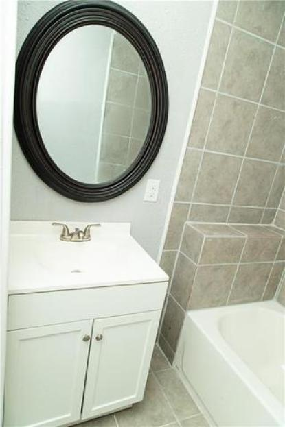 Bathroom featured at 605 W Huisache Ave, Kingsville, TX 78363