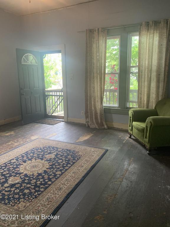 Living room featured at 1849 Bank St, Louisville, KY 40203