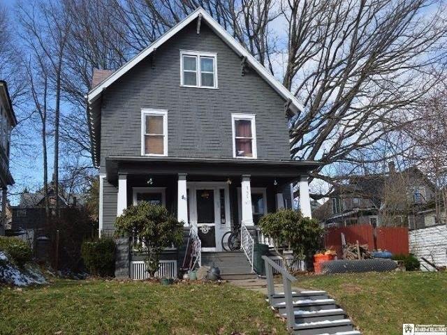 Porch yard featured at 351 Van Buren St, Jamestown, NY 14701