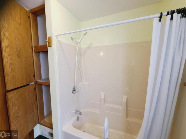 Bathroom featured at 227 N Main St, Conrad, IA 50621