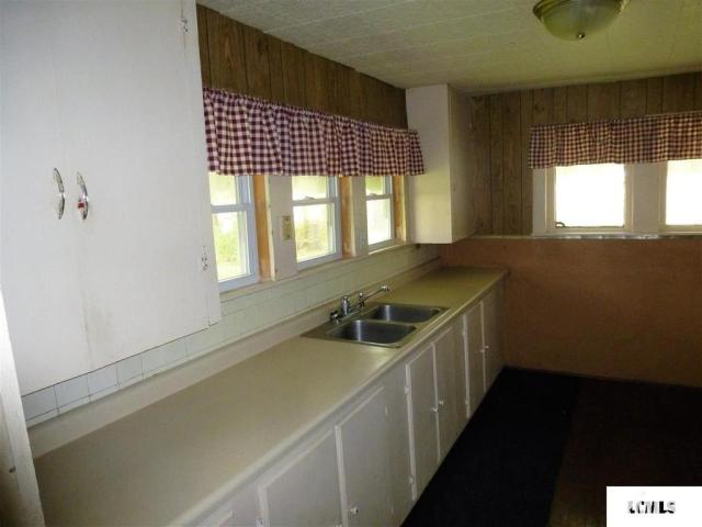 Kitchen featured at 107 NE Church St, Atlanta, IL 61723