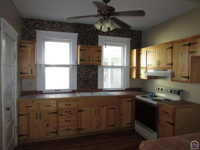 Kitchen featured at 815 SW Lincoln St, Topeka, KS 66606