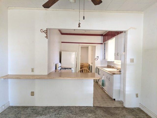 Kitchen featured at 813 W 6th St, Coffeyville, KS 67337