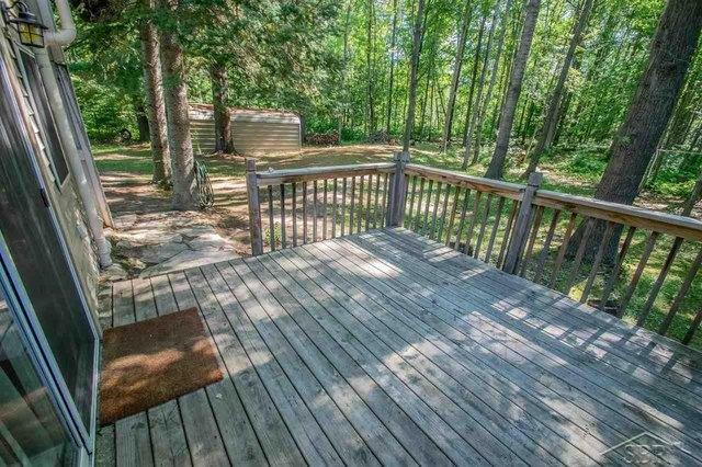 Porch featured at 2647 S Whitney Beach Rd, Beaverton, MI 48612