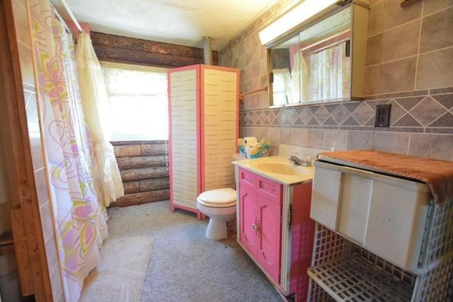 Bathroom featured at 25 Rochester St, Dryden, NY 13053