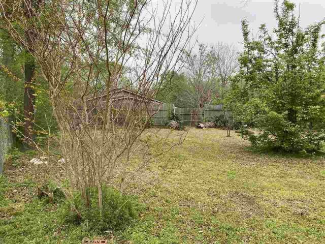 Yard featured at 111 S High St, Henderson, TX 75654