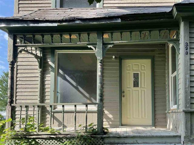 Porch featured at 329 E Main St, Hawkeye, IA 52147