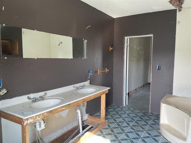Bathroom featured at 329 E Main St, Hawkeye, IA 52147