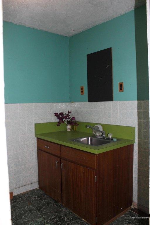 Bathroom featured at 74 Riverside St, Milo, ME 04463