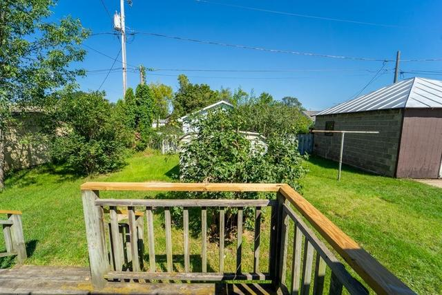 Porch yard featured at 206 E Main St, Weyauwega, WI 54983