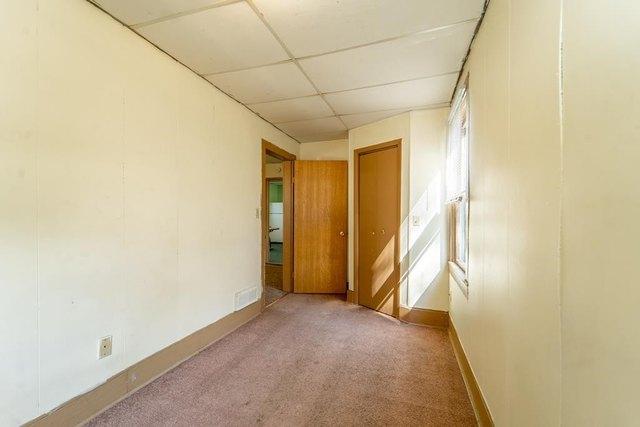 Bedroom featured at 206 E Main St, Weyauwega, WI 54983