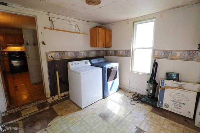 Laundry room featured at 300 S Carthage St, Exira, IA 50076
