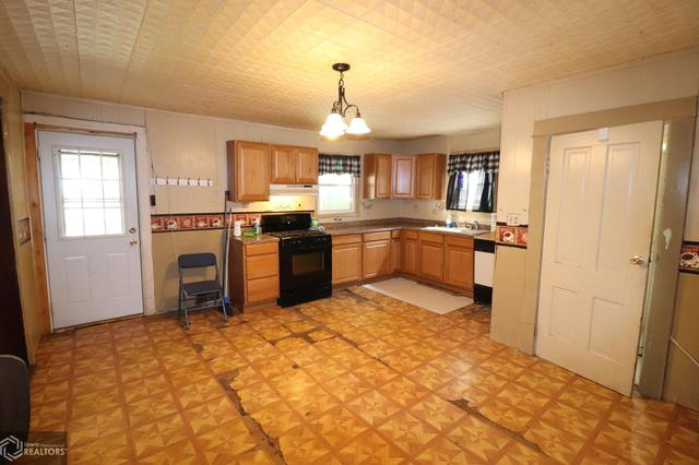 Kitchen featured at 300 S Carthage St, Exira, IA 50076