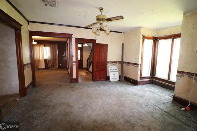 Living room featured at 300 S Carthage St, Exira, IA 50076