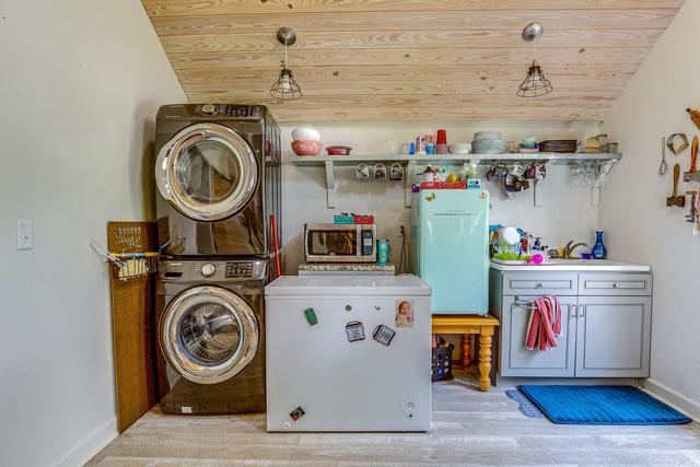 Laundry room featured at 452 N Spring St, Crestview, FL 32536