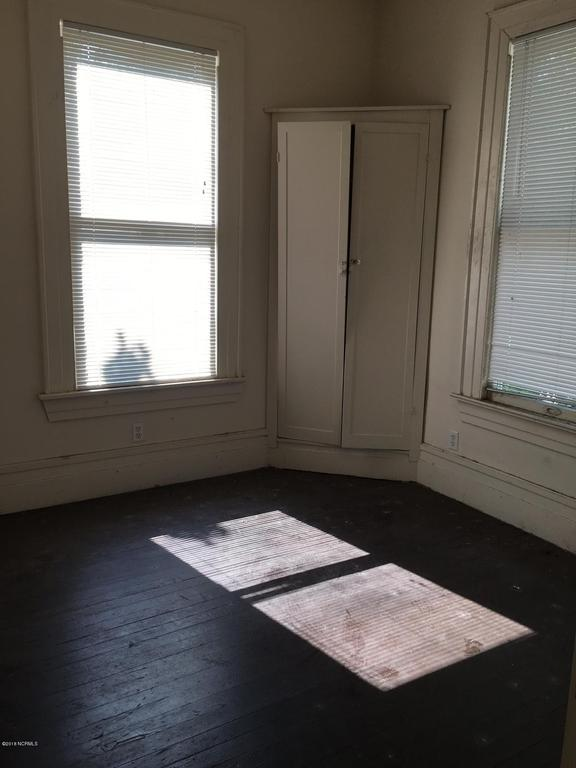 Bedroom featured at 601 Nash St W, Wilson, NC 27893