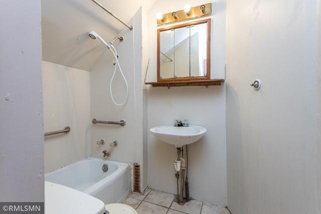 Bathroom featured at 308 S Redwood St, Winthrop, MN 55396