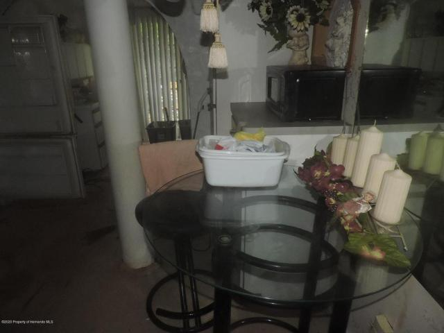 Dining room featured at 7032 Riverrun Rd, New Port Richey, FL 34655