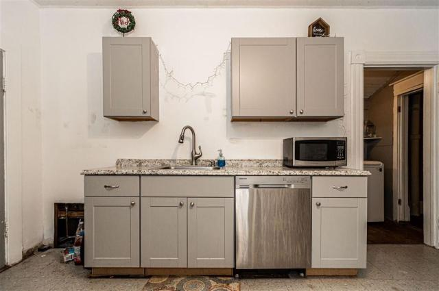 Laundry room featured at 703 W 8th St, Junction City, KS 66441