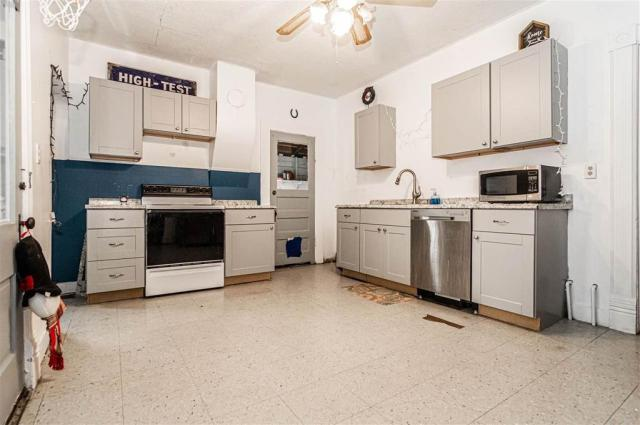 Kitchen featured at 703 W 8th St, Junction City, KS 66441