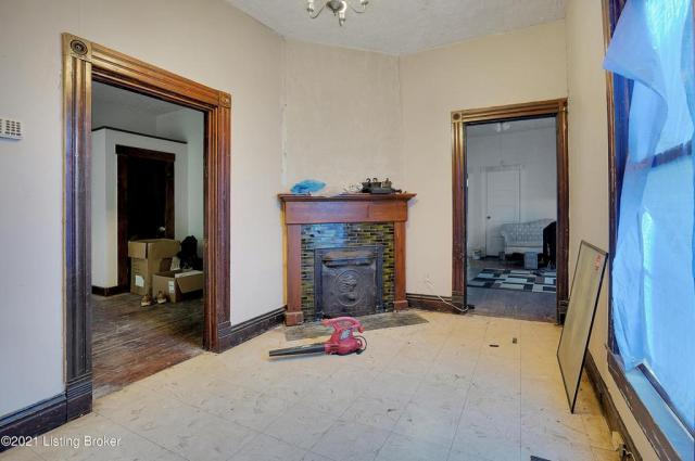 Living room featured at 1359 Olive St, Louisville, KY 40211