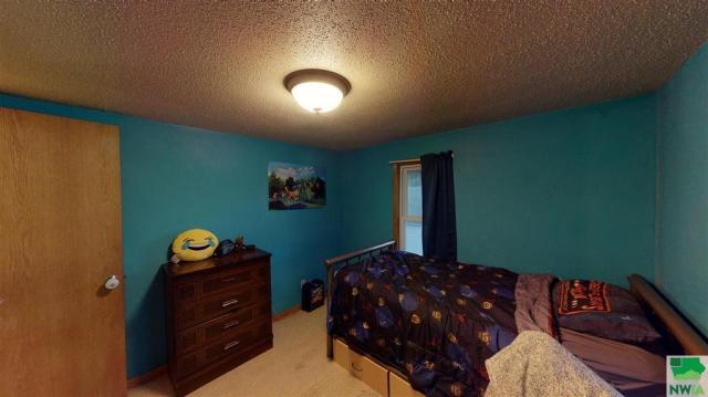 Bedroom featured at 115 E Linn St, Cherokee, IA 51012