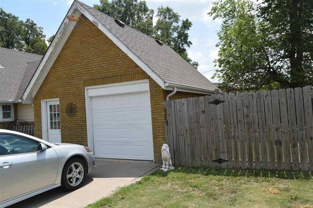 Garage featured at 228 E 1st St, Russell, KS 67665