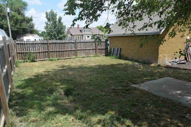 Yard featured at 228 E 1st St, Russell, KS 67665