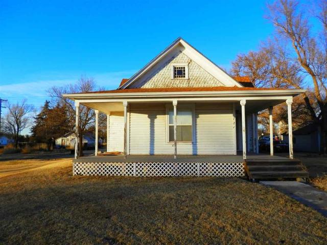 Porch featured at 721 E 2nd St, Russell, KS 67665
