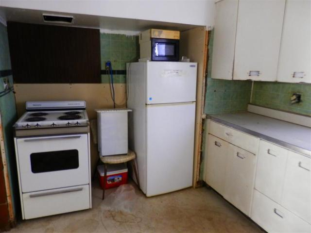 Kitchen featured at 721 E 2nd St, Russell, KS 67665