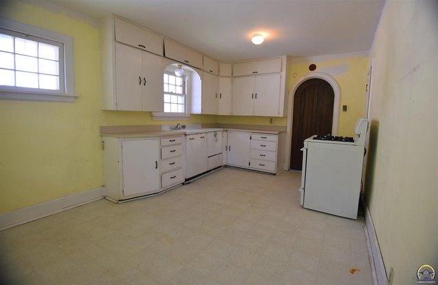 Kitchen featured at 205 NW Elmwood Ave, Topeka, KS 66606