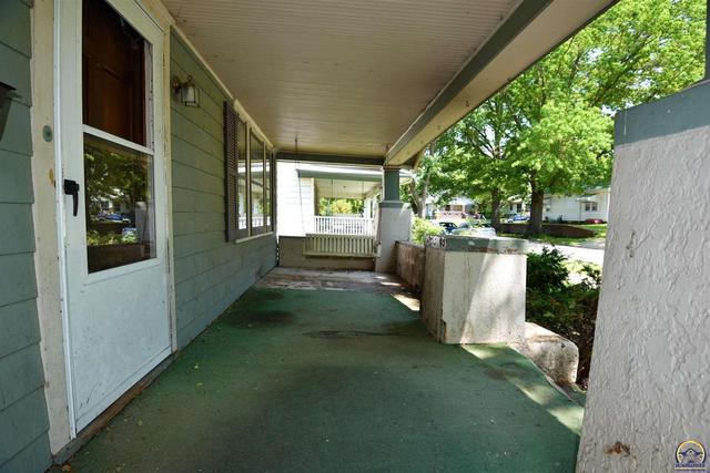 Porch featured at 205 NW Elmwood Ave, Topeka, KS 66606