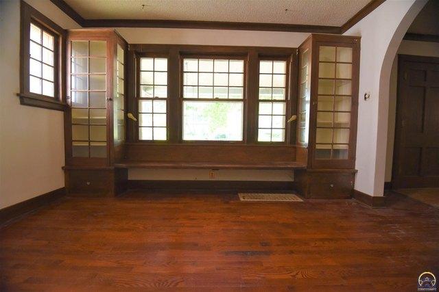 Property featured at 205 NW Elmwood Ave, Topeka, KS 66606