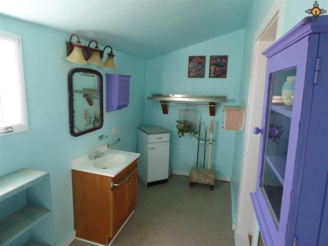 Laundry room featured at 517 S 2nd St, Raton, NM 87740