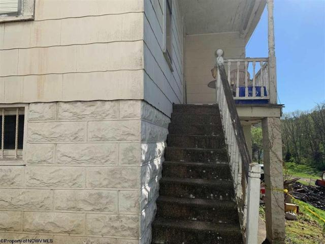 Porch featured at 220 S Howard St, Clarksburg, WV 26301